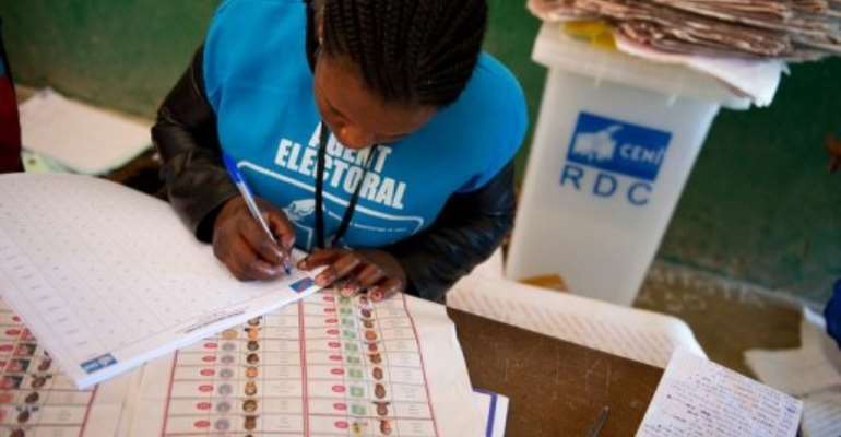 An election official at the Twalemishe school polling station begins counting votes in November 2011.  By Phil Moore (AFP/File)