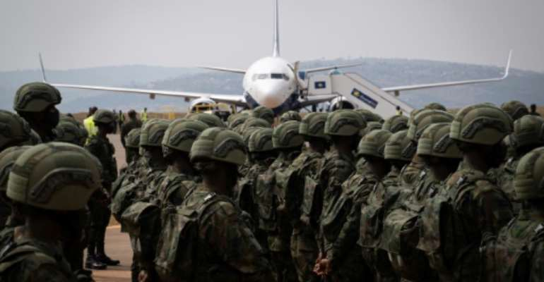 Europe's mission adds to international efforts to help Mozambique tackle the jihadist insurgency in the north of the country. Above: Rwandan troops and policemen who left for the region on Saturday.  By Simon Wohlfahrt (AFP)