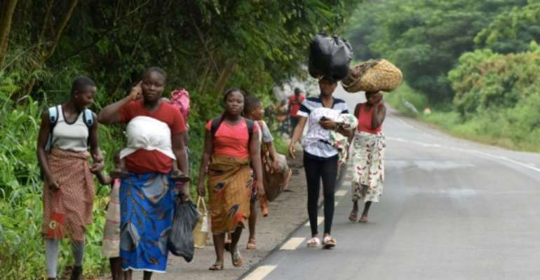 Exodus: Residents flee Bongouanou in east-central Ivory Coast after inter-community clashes ahead of Saturday's elections.  By Issouf SANOGO (AFP)
