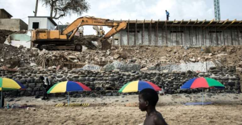 Exploitable land is limited in the rapidly expanding Senegalese capital of Dakar.  By JOHN WESSELS (AFP)