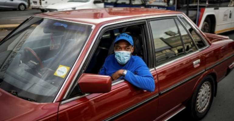 Face masks are becoming an increasingly common sight in Johannesburg as the coronavirus spreads throughout sub-Saharan Africa.  By Michele Spatari (AFP)