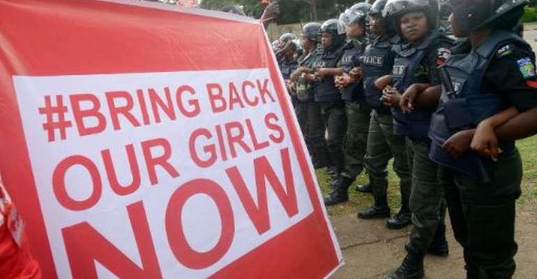 Supporters of the #BringBackOurGirls campaign demonstrate in Abuja on October 14, 2014.  By Pius Utomi Ekpei (AFP)