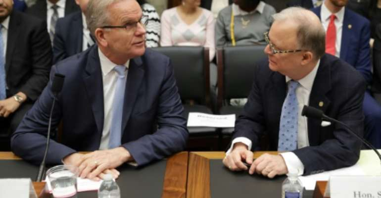 Federal Aviation Administration acting Administrator Daniel Elwell (L) and National Transportation Safety Board Chairman Robert Sumwalt talk before testifying at a House panel on the Boeing 737 MAX.  By CHIP SOMODEVILLA (GETTY IMAGES NORTH AMERICA/AFP)
