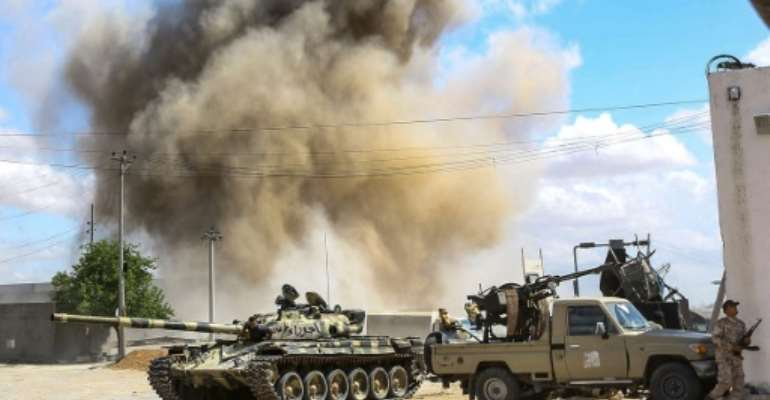 Fierce fighting south of Tripoli has left more than 120 dead, with aid organisations voicing increasing concern for civilians caught in the conflict.  By Mahmud TURKIA (AFP)