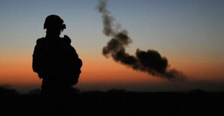 A French soldier watches a controlled explosion in the northern Mali town of Gao, on February 14, 2013.  By Pascal Guyot (AFP/File)