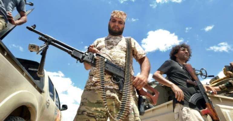 Fighters loyal to Libya's UN-recognised unity government secure the Abu Qurain area last month, half-way between the countries' rival power centres, the capital Tripoli in the west and second city Benghazi in the east.  By Mahmud TURKIA (AFP)