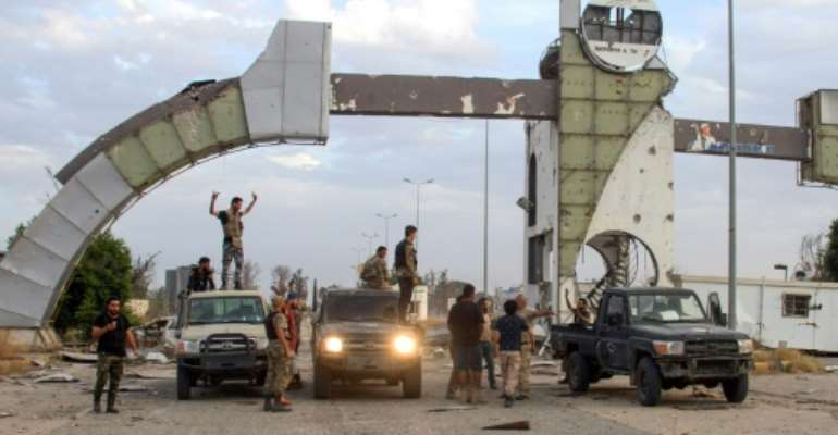 Fighters loyal to the UN-recognized Libyan Government of National Accord recapture Tripoli International Airport after clashes with strongman Khalifa Haftar.  By - (AFP)
