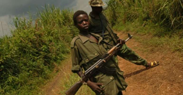 Fighters of the Front for Patriotic Resistance in Ituri (FRPI), which signed a peace deal with the government in February.  By LIONEL HEALING (AFP/File)