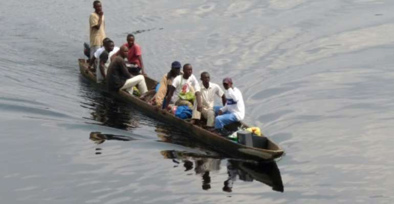 File picture of a motorised canoe, also called a pirogue, which is widely used to transport people and goods in DR Congo. Accidents are common, often due to overloading.  By GUY-GERVAIS KITINA (AFP)