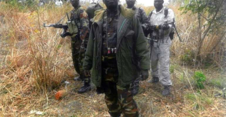 File picture of Abdoulaye Miskine with members of his armed group. The photo, which is undated, was published in April 2013.  By - (FDPC/AFP/File)