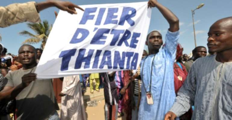 File picture of Thioune's supporters, called 'Thiantacounes,' protesting outside a Dakar prison in October 2012 to demand his release. The placard reads