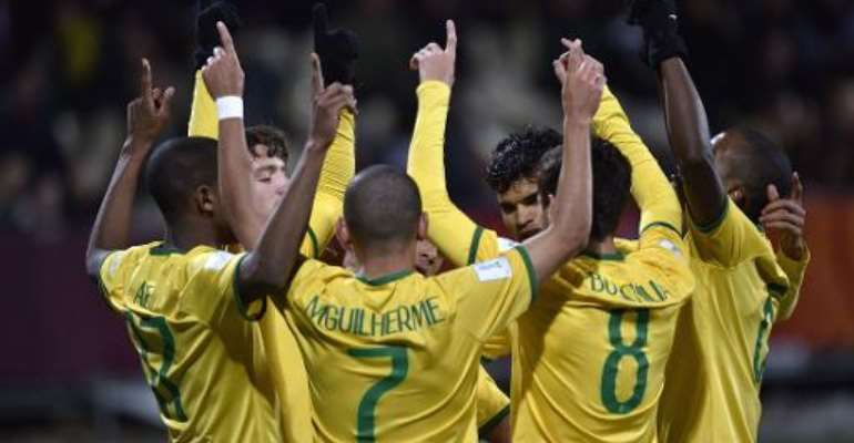 Brazil celebrate a goal during the FIFA Under-20 World Cup semi-final against Senegal at Christchurch Stadium in New Zealand on June 17, 2015.  By Marty Melville (AFP)