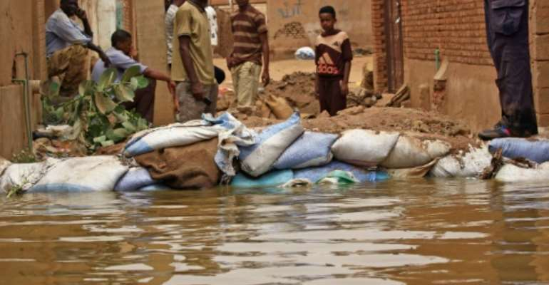 Flood waters from the Nile have swamped the Sudan's Tuti island, wedged between the twin cities of Khartoum and Omdurman, destroying homes and forcing people to flee.  By ASHRAF SHAZLY (AFP)