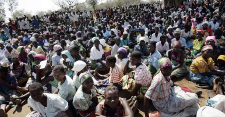 Malawian farmers from Tengani village, in Nsanje district wait to get a ration of maize in 2005.  By Gianluigi Guercia (AFP/File)