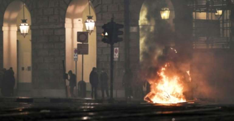 Following weekend demonstrations that saw violence in Italy, crowds ranging in size from several hundred to several thousand took to the streets again on Monday evening..  By Marco BERTORELLO (AFP)