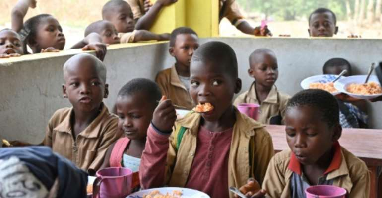 For these Ivorian children, the canteen is a big draw of primary schooling made possible by village women.  By ISSOUF SANOGO (AFP/File)