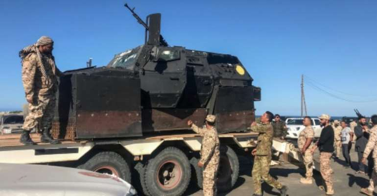 Forces loyal to Libya's UN-backed unity government have sent reinforcements to defend Tripoli.  By Mahmud TURKIA (AFP/File)