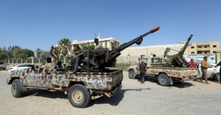 Forces loyal to Libya's unity government take up positions south of Tripoli to block an advance by fighters from Khalifa Haftar's self-styled Libyan National Army.  By Mahmud TURKIA (AFP)