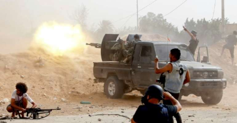 Forces loyal to Libya's UN-recognised government have been fighting to stop an offensive on the capital Tripoli launched in April by the self-styled Libyan National Army.  By Mahmud TURKIA (AFP)