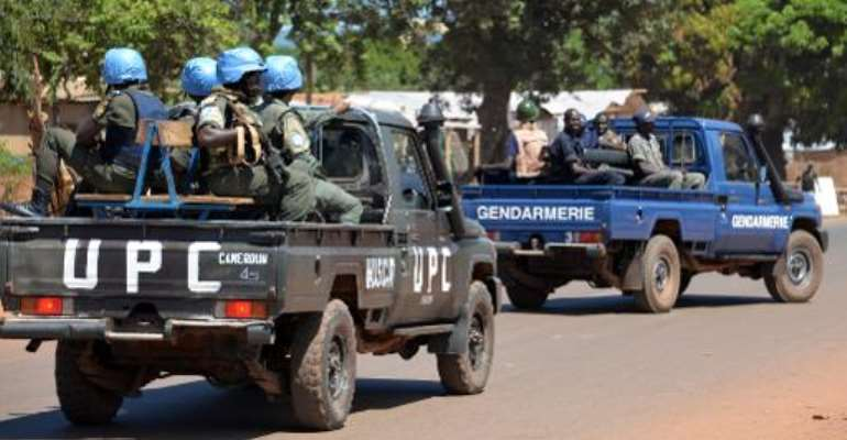 Police and gendarmes assisted by UN troops (MINUSCA)patrol in the capital Bangui on October 2, 2014.  By Pacome Pabandji (AFP/File)