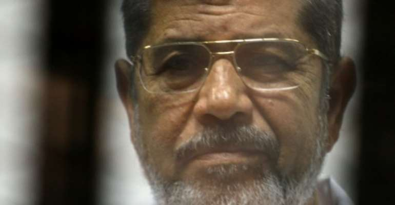 Former Egyptian president Mohamed Morsi, who died on June 17, 2019, had been in prison since his ouster nearly six years ago.  By TAREK EL-GABASS (AFP/File)
