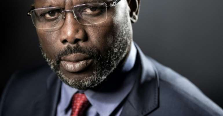 Former football player George Weah is leading the race for Liberia's presidency, with around one third of votes counted.  By JOEL SAGET (AFP)