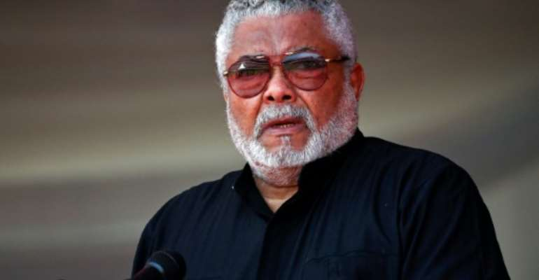 Former Ghana President Jerry Rawlings will be buried, finally, on Wednesday.  By TONY KARUMBA (AFP)