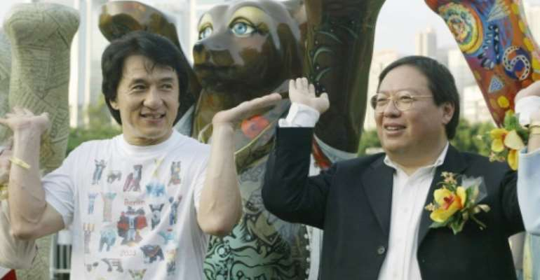 Former Hong Kong home affairs secretary Patrick Ho Chi Ping (R), pictured in a 2003 photograph with movie star Jackie Chan, was sentenced to three years in prison over a bribery scheme.  By SAMANTHA SIN (AFP/File)