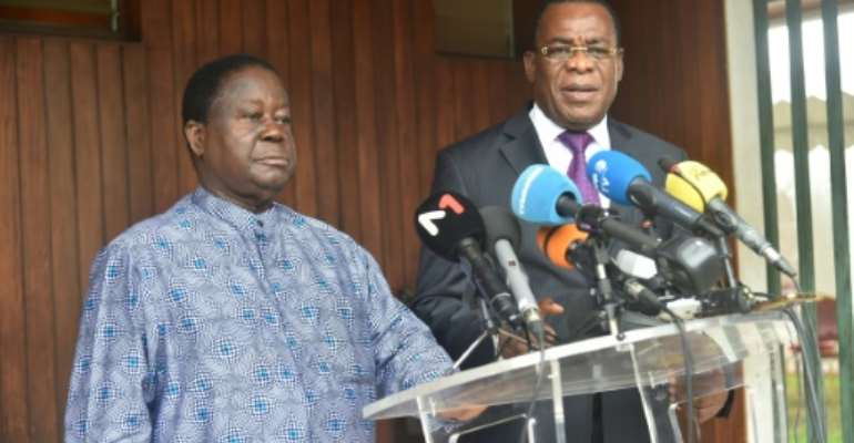 Former Ivorian president Henri Konan Bedie (L) and and ex prime minister Pascal Affi N'Guessan asked supporters to boycott the electoral process.  By SIA KAMBOU (AFP)