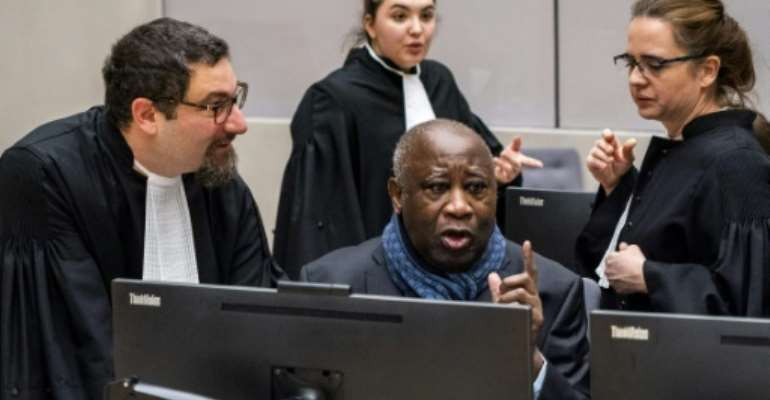Former Ivory Coast President Laurent Gbagbo (C) has asked the ICC for unconditional release following his acquittal last year.  By Jerry LAMPEN (ANP/AFP)