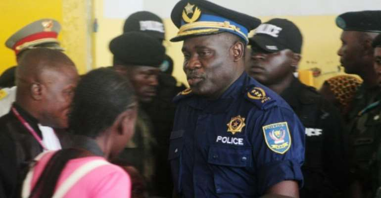 Former police chief John Numbi, centre, pictured in January 2011 at the trial of policemen accused of killing rights activist Floribert Chebeya.  By Junior KANNAH (AFP)