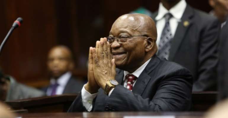 Former South African president Jacob Zuma, pictured in the dock in Durban on Friday. He faces 16 charges of corruption that date to before his time as president.  By Jackie CLAUSEN (POOL/AFP)