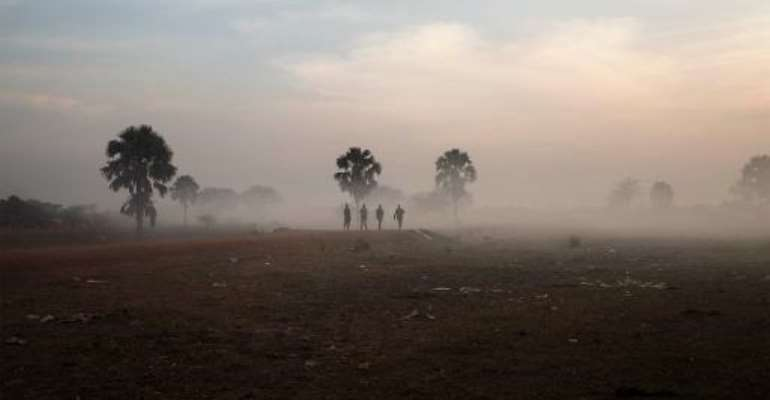 Government soldiers walk along the road that connects the central South Sudanese town of Yirol with the north of the country on February 12, 2014.  By Fabio Bucciarelli (AFP/File)