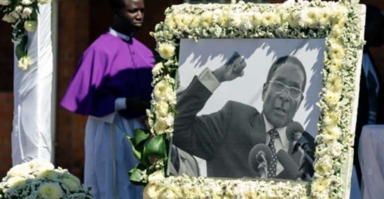 Former Zimbabwe president Robert Mugabe was finally buried in a Christian ceremony this weekend.  By Jekesai NJIKIZANA (AFP)