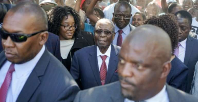 Former Zimbabwean president Robert Mugabe (centre), seen here during last year's elections, is still in hospital in Singapore after four months treatment for an undisclosed ailment.  By Zinyange AUNTONY (AFP)