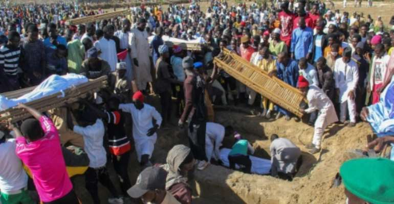 Forty-three farm workers and buried at a mass funeral after the Boko Haram attack in northeastern Nigeria.  By Audu Marte (AFP/File)
