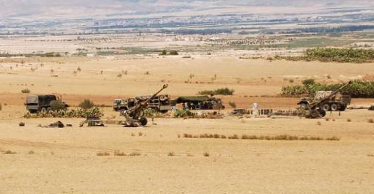 Tunisian forces are seen stationed in the Mount Chaambi area during an operation against Islamist militants near the Algerian border on August 2, 2013.  By Abderrazek Khlifi (AFP/File)