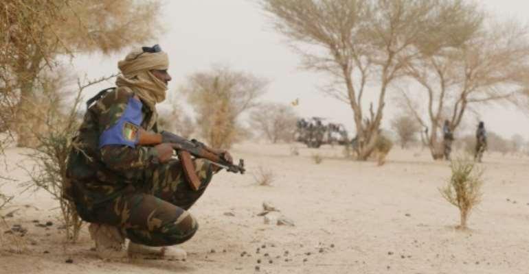 Malian soldiers patrol between Gao and Kidal on July 26, 2013 in northern Mali.  By Kenzo Tribouillard (AFP/File)