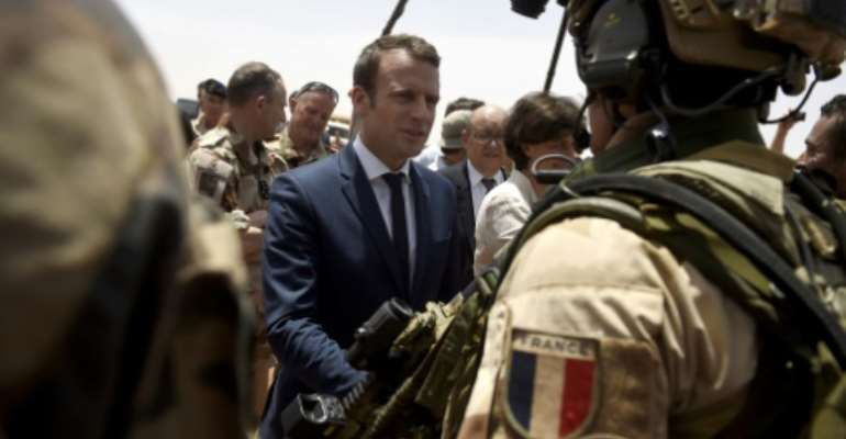 France is attempting to overcome US reservations about financial backing for anti-terrorism forces in the Sahel region of Africa, pictured in May 2017 when French President Emmanuel Macron (C), visited the French troops in northern Mali.  By CHRISTOPHE PETIT TESSON (POOL/AFP)