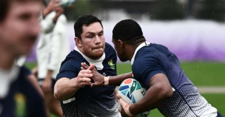 Francois Louw (L) is one of the Springboks players who are based in England.  By Anne-Christine POUJOULAT (AFP)