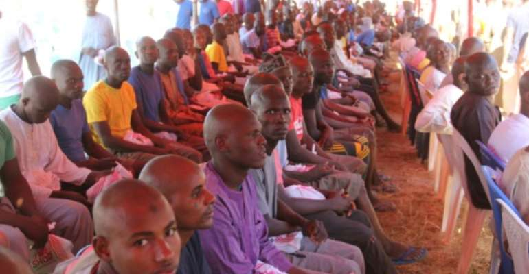 Freed: Former inmates at the ceremony in Maiduguri, where they were declared to have been cleared of being Boko Haram suspects.  By Audu Marte (AFP)