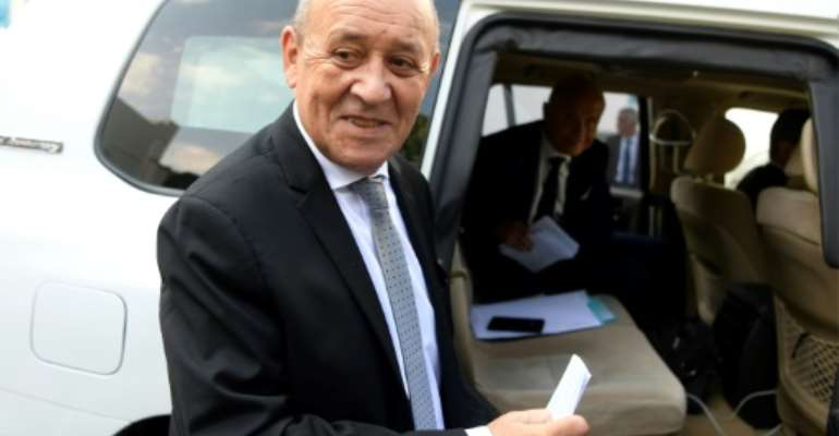 French Foreign Affairs Minister Jean-Yves Le Drian in Tunisia for talks on the Libyan conflict.  By FETHI BELAID (AFP)