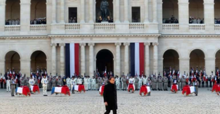 French President Emmanuel Macron said he bowed before the soldiers' 'sacrifice'.  By Thibault Camus (POOL/AFP)