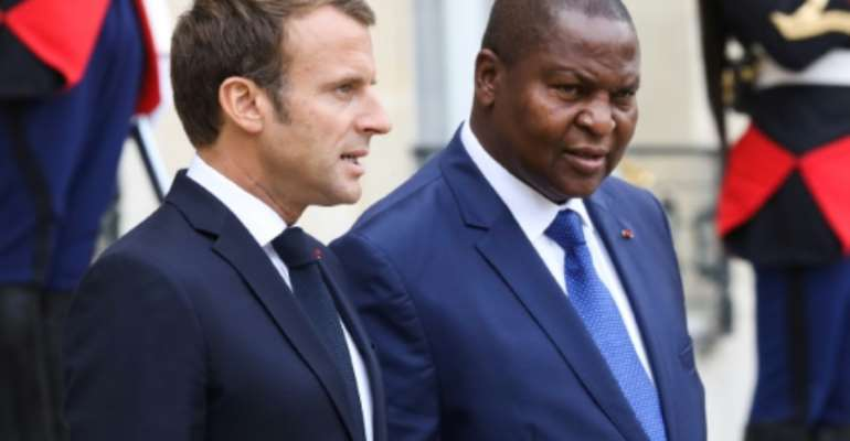 French President Emmanuel Macron with Central African Republic's President Faustin-Archange Touadera after talks in Paris on Thursday..  By ludovic MARIN (AFP)