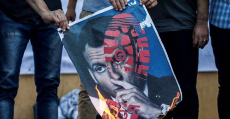French President Emmanuel Macron's defence of cartoons depicting the Prophet Mohammed have sparked widespread protests, including here in Gaza on Tuesday, but in Tunisia it has triggered a wider debate.  By MAHMUD HAMS (AFP)