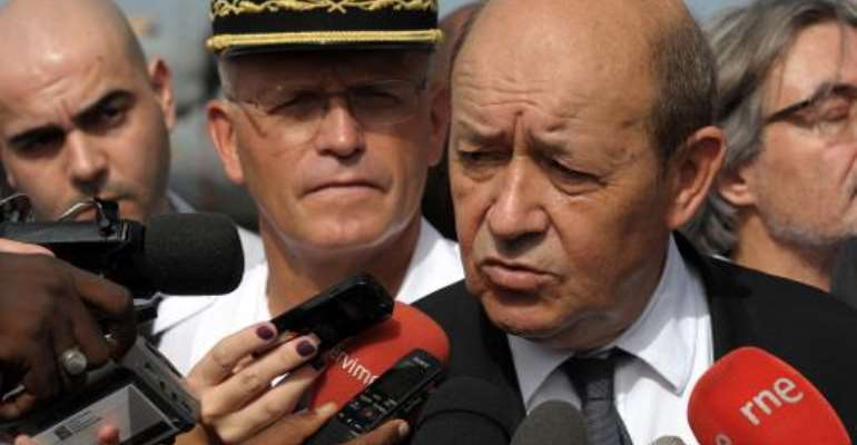 French Defense Minister Jean-Yves Le Drian speaks to the press during a visit to a French military airforce base in Dakar, October 24, 2014.  By Seyllou (AFP/File)