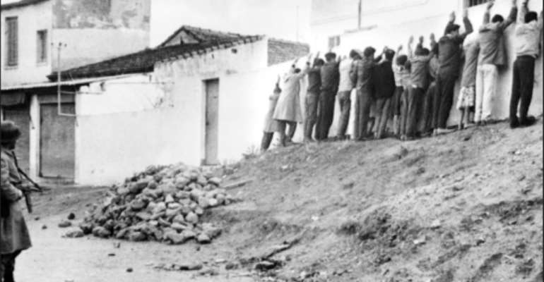 French troops line Algerians up against a wall in Algiers in December, 1960.  By STF (AFP/File)