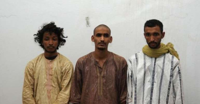 The kidnappers of two Frenchmen snatched in Mali last month are shown to the press in Bamako.  By Habib Kouyate (AFP)