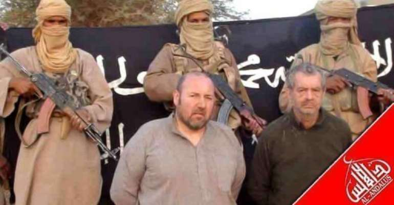 French nationals Philippe Verdon (L) and Serge Lazarevic being held by AQIM at an undisclosed location.  By  (AFP/ANI/File)