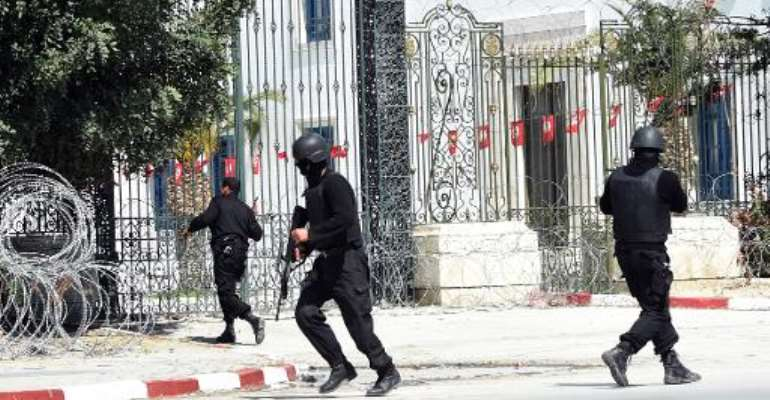 Tunisian security forces secure the area after gunmen attacked Tunis' famed Bardo Museum on March 18, 2015.  By Fethi Belaid (AFP/File)